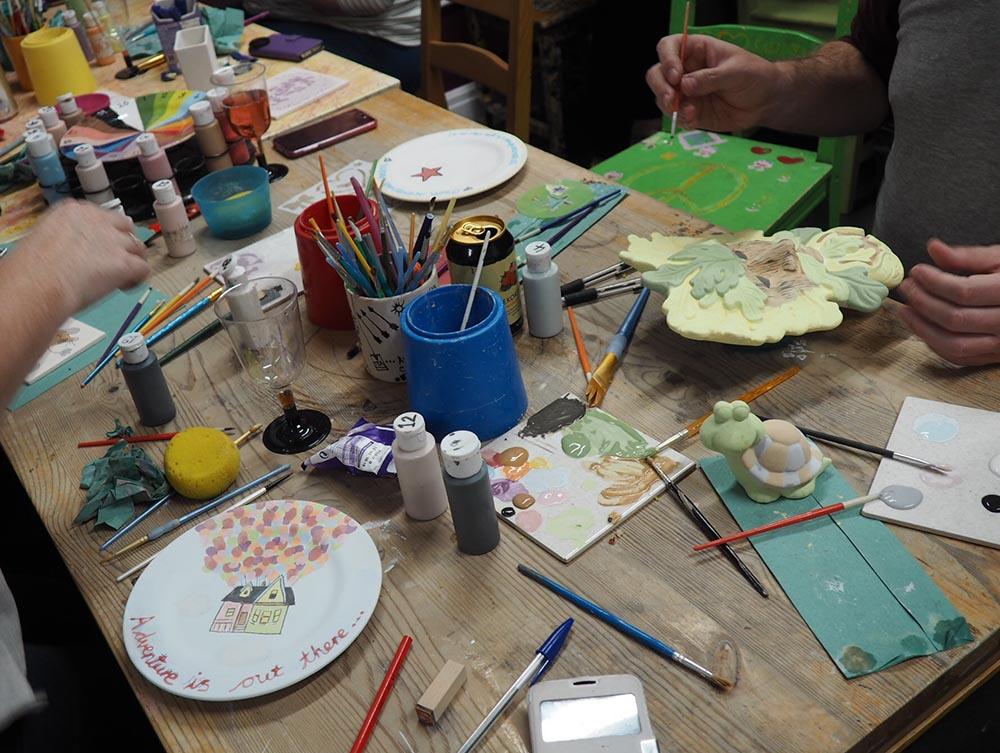 Painting pottery at Glazey Days