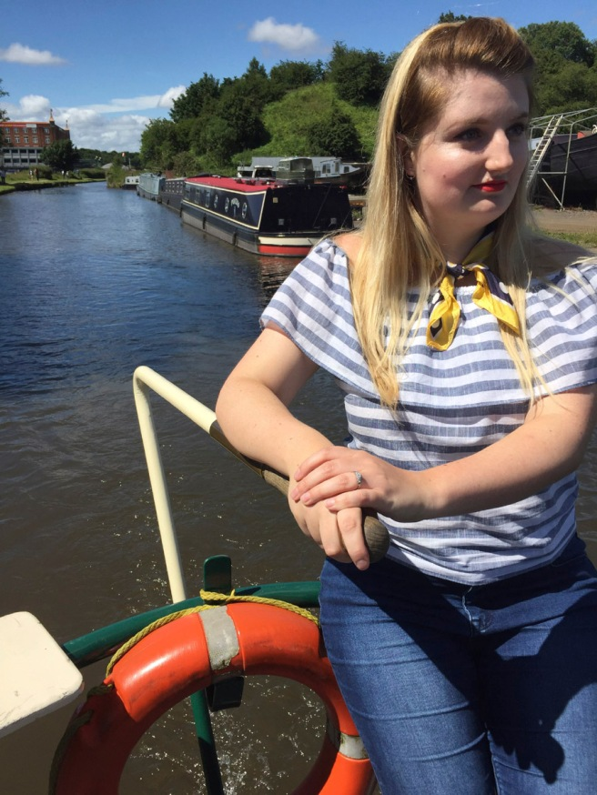 Canal boat at the helm